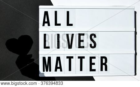 All Lives Matter Text With Deep Shadows Of Heart On A Black And White Background. Protest Against Th