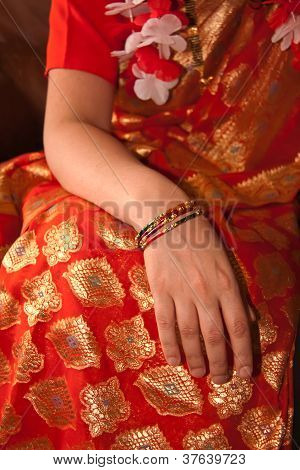 Orange Sari With Bangled Wrist