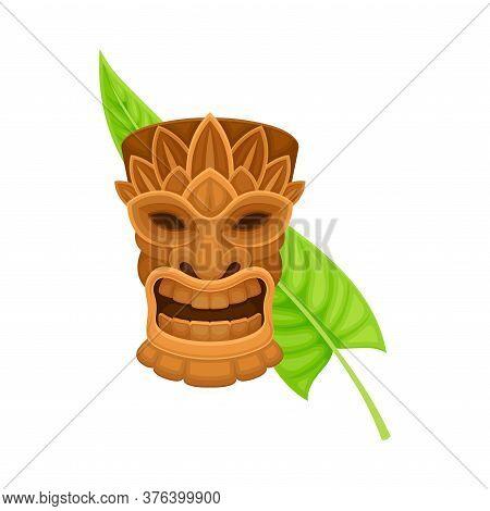 Wooden Carved Mask Or Tiki With Green Palm Leaf Vector Illustration