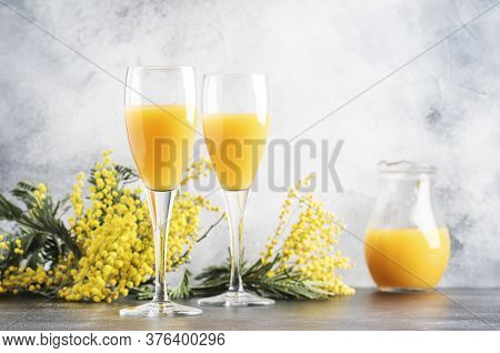Spring Alcohol Cocktail Mimosa With Orange Juice And Cold Dry Champagne Or Sparkling Wine In Glasses