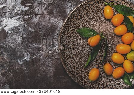 Fresh Kumquat With Leaves, Top View With Copy Space
