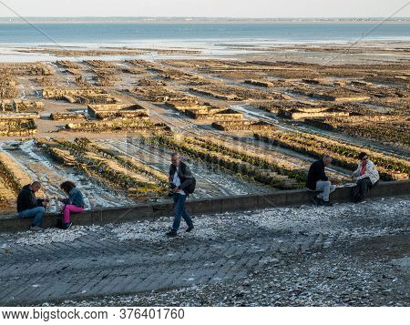 Cancale, France - September 13, 2018: People Eating Oysters Bought On The Seafront At Cancale, Britt