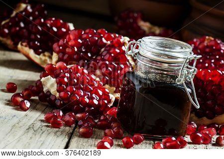 Pomegranate Jam, Fresh Pomegranate, Dark Wood Background, Selective Focus