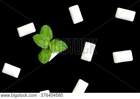 White Chewing Pads On A Black Background