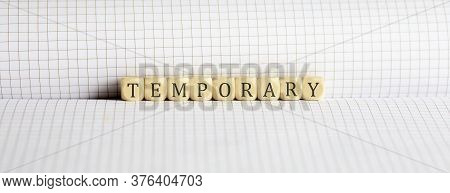 Concept Temporary. Words Written On A Wooden Block On Notebook. Leadership Concept.