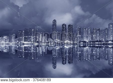 Panorama Of Skyline And Harbor Of Midtown Of Hong Kong City At Dusk