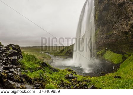 Seljalandsfoss, Waterfall In The South Region In Iceland, Part Of The Seljalands River That Has Its