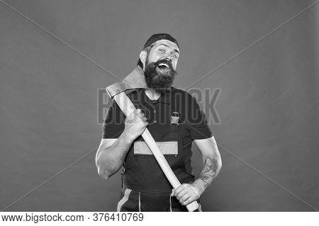 Destroy. Man Builder Uniform Hold Axe. Man Builder Hold Ax Red Background. Renovation Concept. Beard
