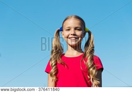 Beauty Is Whatever Gives Joy. Happy Child Smile On Sunny Blue Sky. Beauty Look Of Small Girl. Beauty