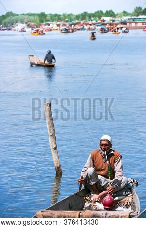 Srinagar, Jammu, Kashmir, India - August 01, 2020 : Lifestyle Of Local Indian Old Man Relaxing And S