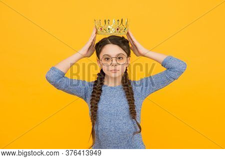 Admiration Is The Reward. Little Beauty Queen Yellow Background. Small Child Got Crown As Reward. Je