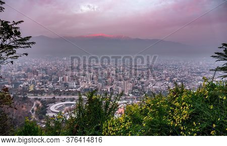 Santiago De Chile Downtown At Dusk With Andes In The Background