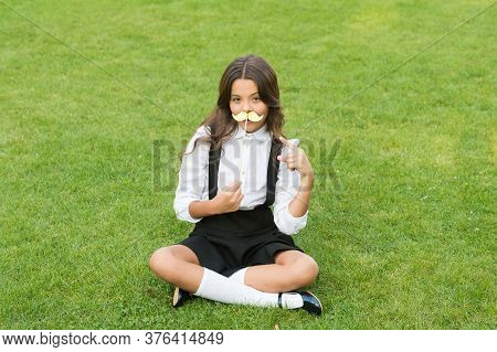 Funny Party Concept. Cute Mustache. Small Girl Hold Fake Mustache On Face. Happy Childhood. Little C