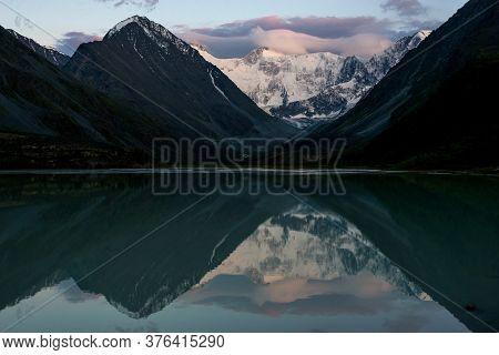 Belukha Peak At Sunset Is Reflected In The Mountain Lake Ak-kem