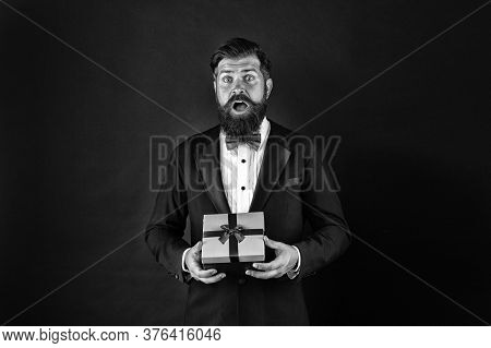 Gifting Surprise For All. Surprised Man With Open Mouth. Businessman Got Surprise. Hipster Hold Surp
