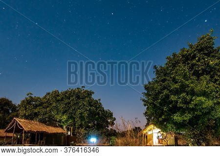 Night View Of Wooden Shacks Under The Sky