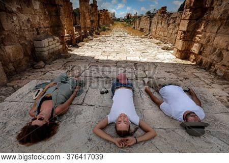 Best Friends Spending Day in the Ruins of Tyre. Resting after Excursion along Necropolis in Lebanon. Touristic Place. World Heritage. Active People Taveling. Summer Vacation.