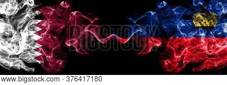 Qatar Vs Liechtenstein, Liechtensteins Smoky Mystic Flags Placed Side By Side. Thick Colored Silky A