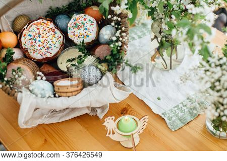 Traditional Easter Basket For Blessings In Church. Easter Modern Eggs, Cake, Ham, Beets, Butter In R