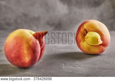 An Ugly Fruit Or Vegetable. Strongly Ugly Peach Mutants On A Gray Background. Ugly Fruits Are Not In