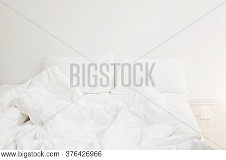 Cozy White Bed In The Morning. White Sheets And Pillow On Bed In Modern White Room. Lazy Days. Stay