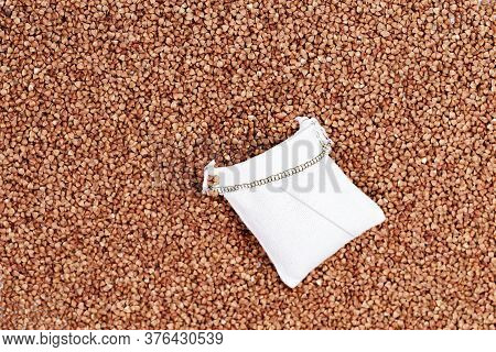 Full Sack Bag Of Buckwheat On Background Of Cereal Grains. Healthy Food. Natural Organic Grain. Rich