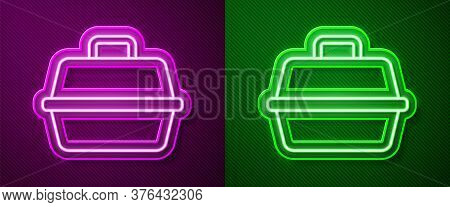 Glowing Neon Line Pet Carry Case Icon Isolated On Purple And Green Background. Carrier For Animals,