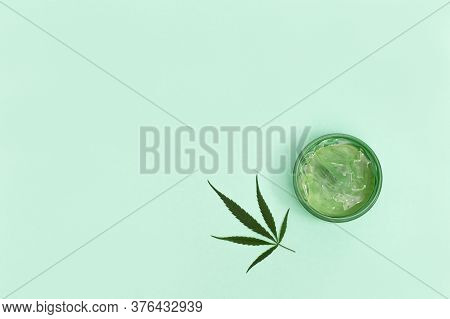 Cannabis Beauty Products That Contain Natural Ingredients Of Plant Origin. Jar Of Hemp Cream And Gre