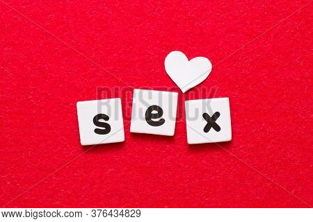 Black Printed Word Sex On Red Background With Little White Heart