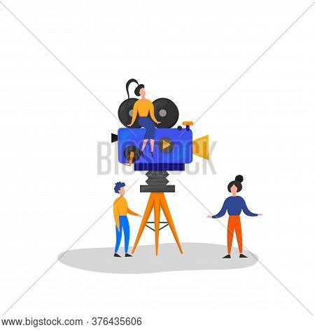 Tiny Characters Making Movie. Operator Using Camera And Staff With Professional Equipment Recording