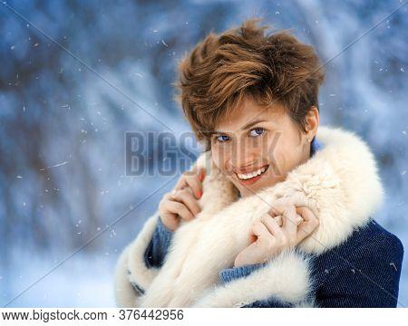 Winter Woman With Short Haircut In Luxury Fur Coat. Beauty Fashion Model Girl In Blue Fox Fur Coat.