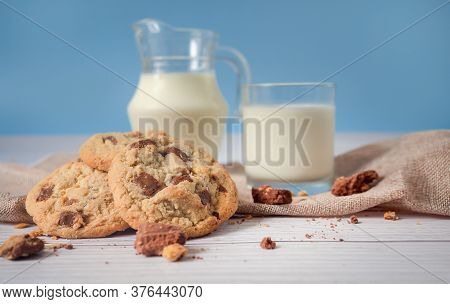 Delicious Homemade Chocolate Chip Cookies, Paired With Fresh Milk In A Glass And Pitcher, Placed On