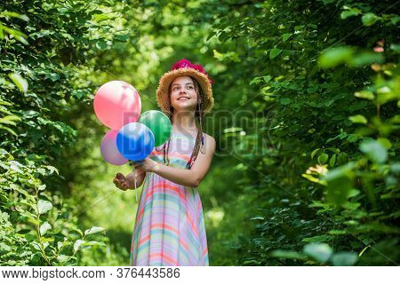 Source Of Beauty. Beautiful Girl With Party Balloons. Little Girl Has Fresh Blossoming Flower Of Ros