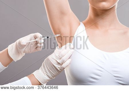 Woman Receiving Underarm Treatment Against Hyperhidrosis. Armpit Injections To Prevent Excessive Swe