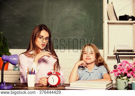 Future Begins In School. Little Girl And Pretty Woman Back To School. Small Child And Teacher In Sch
