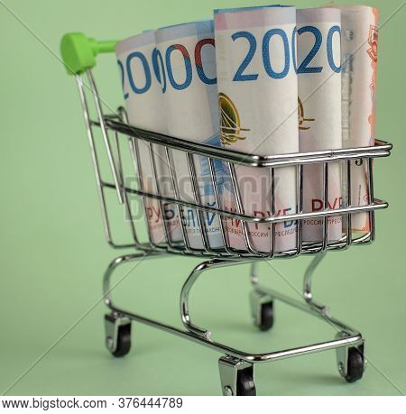 Russian Rubles In A Trolley On A Light Background. Grocery Basket And Russian Rubles. Russian Curren