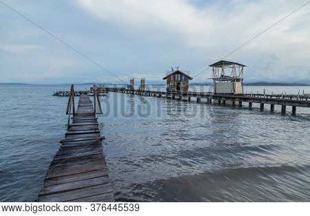 Bocas del Toro, Panama - August 22, 2019: Caribbean houses over the sea with wooden dock on stilts, Bocas del Toro, Panama