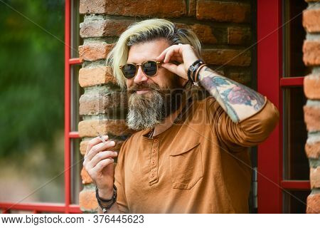 Fashionable Mature Man With Cigarette. Smoking Habit. Brutal Guy Sunglasses Smoking Tobacco. Cool Gu