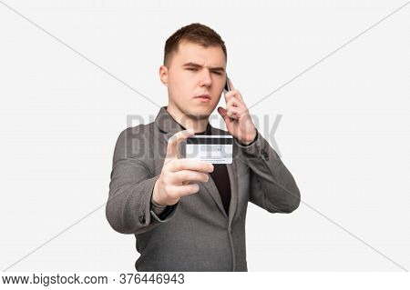 Scam Phone Call. Phishing Attack. Confused Male Bank Client Telling Credit Card Personal Data Isolat