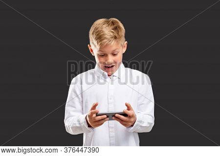 Mobile Game Addiction. Stress Anxiety. Shocked Boy Losing Playing On Phone Isolated On Gray Backgrou