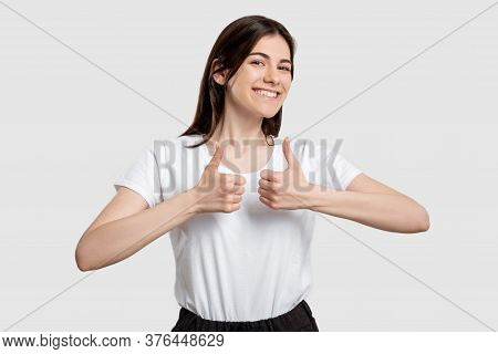 Like Gesture. Super Great. Cheerful Woman Showing Thumbs Up Isolated On Light Background.