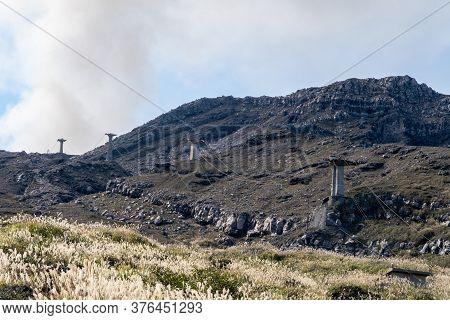 Old Sensuikyo Ropeway Constructions At The Foot Of Mount Aso, Active Volcano On Kyushu Island, Japan