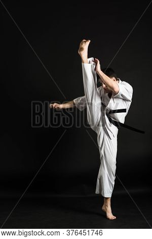 A Karateka Strikes Or Stands In A Stance. Martial Arts. Shidokan Karate. Fighter In The Studio. Kimo
