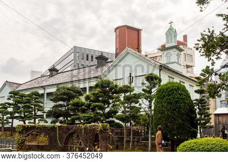 Nagasaki, Japan, 03/11/19. Old European Style White Wooden Roman Catholic Church In Dejima Island Di