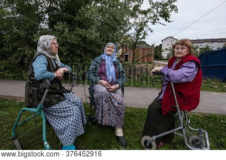 Brcko, Bosnia, May 6, 2017: Senior Bosniak Women, Wearing The Traditional Muslim Scarf, Sitting And