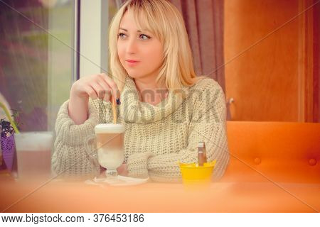 Woman Sitting In A Cozy Cafe White Coffee Break, Woman Enjoying Coffee After Hours, Woman Having Bre