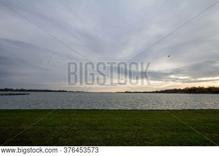Palic Lake, In Subotica, Serbia, With A Green Lawn In The Background, During A Summer Sunset. Also K