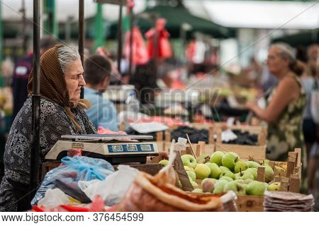 Belgrade, Serbia - August 25, 2018: Senior Old Woman In Traditional Clothes Selling Fruits And Veget