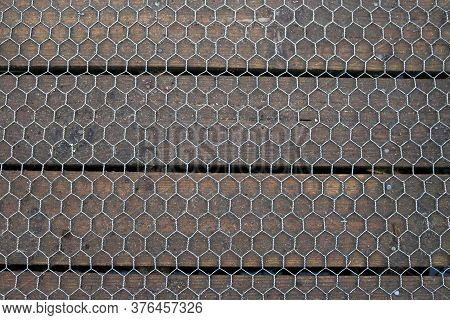 Wooden Plank Boardwalk Covered In Metal Wire Hexagonal Mesh With No Background.