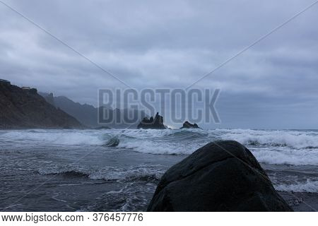 Scary Rock On The Beach On A Cloudy Day